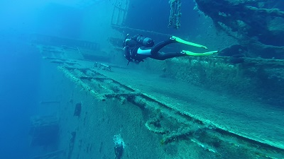 scuba diver exploring the wreck of the zenobia